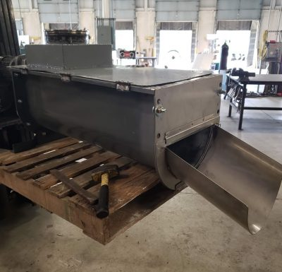 custom designed and fabricated piece sitting on wood skid being held by forklift
